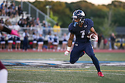 CJ Turner of Eastridge rushes during a game against Greece Arcadia at Eastridge High School on Friday, September 2, 2016.