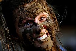 8 JUNE 2008: A female participant shows off her mud after completing the 5k mud run at the annual Teva Mountain Games held in Vail,CO June 5-8 2008.