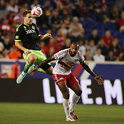 Chad Marshall, Seattle Sounders,  heads clear from Thierry Henry, New York Red Bulls, during the New York Red Bulls Vs Seattle Sounders, Major League Soccer regular season match at Red Bull Arena, Harrison, New Jersey. USA. 20th September 2014. Photo Tim Clayton
