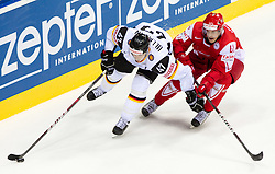Christoph Ullmann of Germany vs Jesper Jensen of Denmark during ice-hockey match between Denmark and Germany of Group E in Qualifying Round of IIHF 2011 World Championship Slovakia, on May 7, 2011 in Orange Arena, Bratislava, Slovakia. Denmark defeated Germany 4-3 after overtime and shootout. (Photo By Vid Ponikvar / Sportida.com)