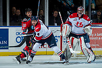 KELOWNA, CANADA - NOVEMBER 17: Carsen Twarynski #18 of the Kelowna Rockets is checked by Tate Olson #4 of the Lethbridge Hurricanes during first period on November 17, 2017 at Prospera Place in Kelowna, British Columbia, Canada.  (Photo by Marissa Baecker/Shoot the Breeze)  *** Local Caption ***