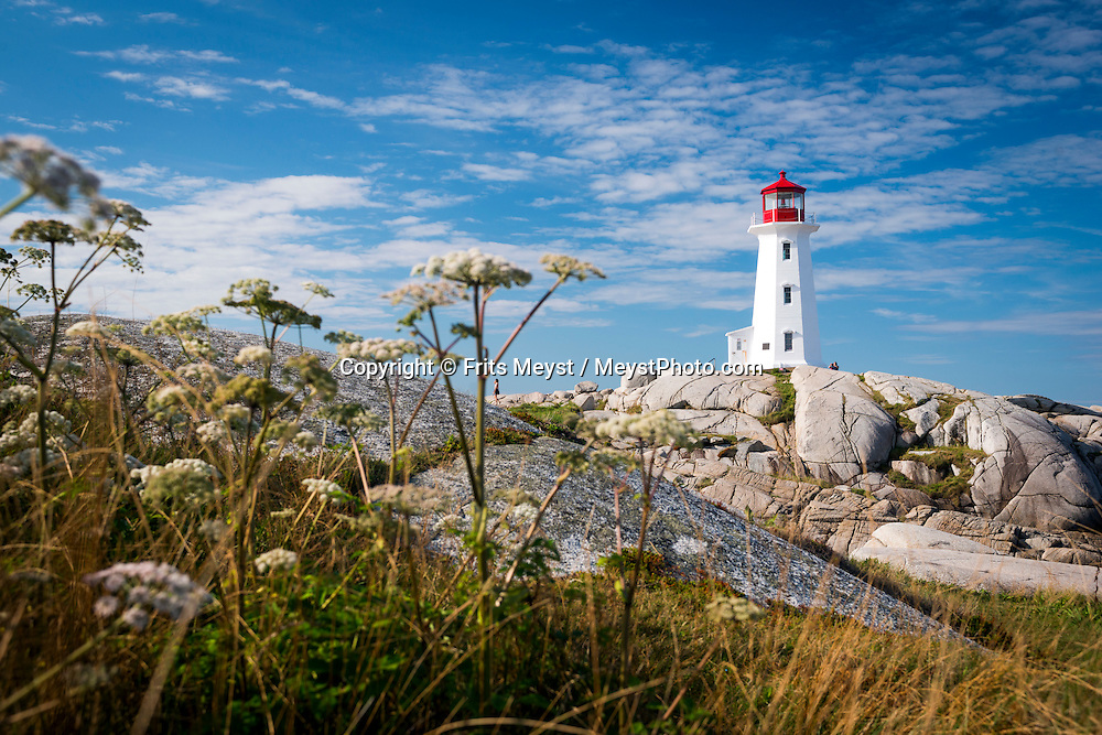 "Peggy's Cove, Nova Scotia, Canada, August 2014. <br /> Peggy's Point Lighthouse, known to many as Peggy's Cove Lighthouse is located in the quaint fishing village of Peggy's Cove. Peggy's Cove is famed for its picturesque and typically East-Coast profile, with houses perched along a narrow inlet and on wave-washed boulders facing the Atlantic. Although this unique environment has been designated a preservation area, it is still an active fishing community. Nova Scotia was one of the original four provinces that became part of Canada in 1867.  ""Nova Scotia"" is Latin for ""New Scotland"", and Scottish settlers brought culture and traditions that continue to this day. Photo by Frits Meyst / MeystPhoto.com"