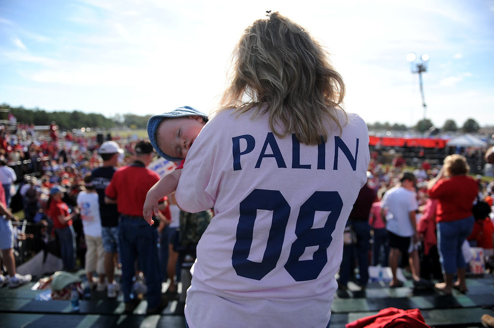 Maria Cackett holds her sleeping 6 month old daughter Gianna during a rally where Republican Vice Presidential Candidate and Alaska Governor Sarah Palin spoke, at the Richmond International Raceway in Richmond, Virginia USA, on 13 October 2008. Palin and her running mate Senator John McCain are behind in many national voter polls.