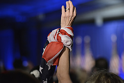 Barbara Robinson, of Montgomery, NJ raises her hand as she attends a rally with Melanie Trump in Chester County, on Thursday.