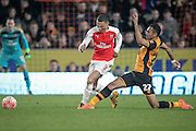 Ahmed Elmohamady (Hull City) toe pokes the ball away from Kieran Gibbs (Arsenal) during the The FA Cup fifth round match between Hull City and Arsenal at the KC Stadium, Kingston upon Hull, England on 8 March 2016. Photo by Mark P Doherty.