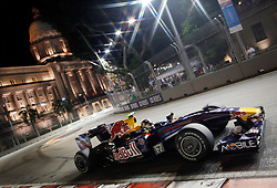 epa01877471 German Formula One driver Sebastian Vettel of Red Bull Racing steers his car during the Grand Prix of Singapore at the Marina Bay Street Circuit in Singapore, 27 September 2009.  EPA/HOW HWEE YOUNG
