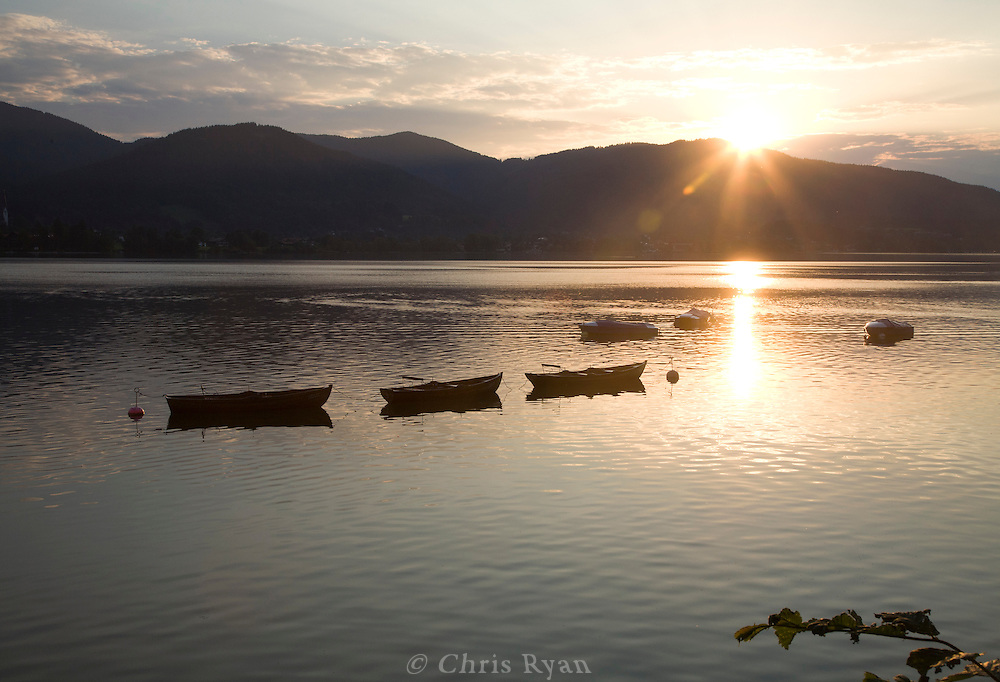 Rowboats at sunset on Tegernsee, Bavaria, Germany