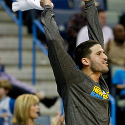 December 30, 2011; New Orleans, LA, USA; New Orleans Hornets guard Greivis Vasquez cheers on his teammates during the fourth quarter of a game against the Phoenix Suns at the New Orleans Arena. The Suns defeated the Hornets 93-78.   Mandatory Credit: Derick E. Hingle-US PRESSWIRE