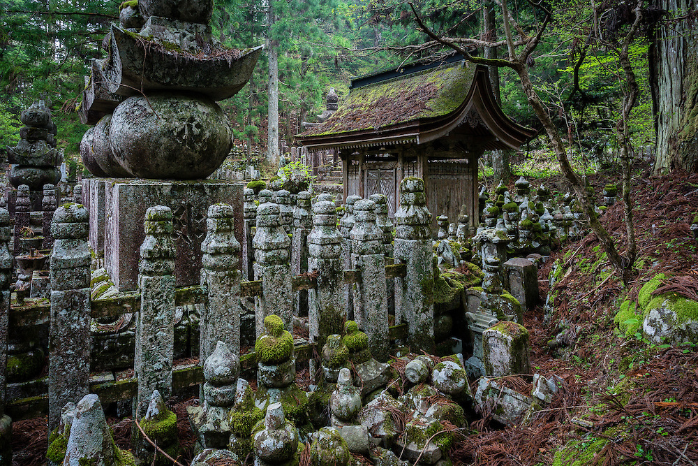 The mausoleum of Sataki Yoshishige, a fierce samurai lord, known for his ferocity in combat, stands amongst several buddhist tombs.