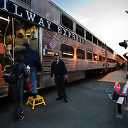 Victor Bennett, conductor, waits as people board the train bound for Washington, DC during the morning commute.