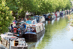 © Licensed to London News Pictures. 29/07/2014. London, UK People relax in the sunshine at Little Venice on Regent's Canal in North London today 29th July 2014. Photo credit : Stephen Simpson/LNP
