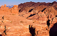 Deep gorge of Charyn Canyon runs for miles near the southern border with China.