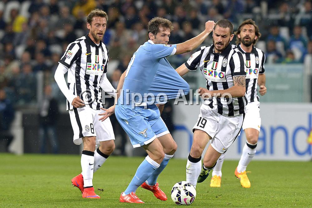 &copy; Filippo Alfero<br /> Juventus-Lazio, Serie A 2014/2015<br /> Torino, 18/04/2015<br /> sport calcio<br /> Nella foto: Senad Lulic e Leonardo Bonucci