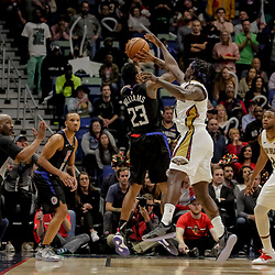 Dec 3, 2018; New Orleans, LA, USA; LA Clippers guard Lou Williams (23) shoots over New Orleans Pelicans guard Jrue Holiday (11) during the fourth quarter at the Smoothie King Center. Mandatory Credit: Derick E. Hingle-USA TODAY Sports