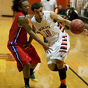 New Hanover's Brad Hitchman drives around Scotland County's Miguel McKeithan. (Jason A. Frizzelle)