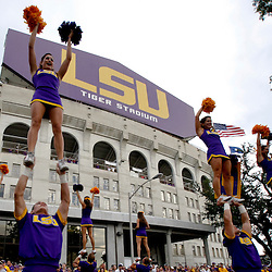 Sep 25, 2010; Baton Rouge, LA, USA; LSU Tigers cheerleaders perform on Victory Hill outside prior to a game between the LSU Tigers and the West Virginia Mountaineers at Tiger Stadium.  Mandatory Credit: Derick E. Hingle
