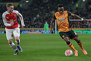Moses Odubajo (Hull City) runs past Calum Chambers (Arsenal) during the The FA Cup fifth round match between Hull City and Arsenal at the KC Stadium, Kingston upon Hull, England on 8 March 2016. Photo by Mark P Doherty.