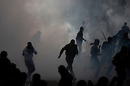 EGYPT, Cairo :  Thousands of  protesters clash with police near the interior ministry in Cairo on February 3, 2012. Egyptian protesters clashed with police for a second straight day as anger against the ruling military mounted ..