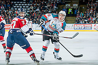 KELOWNA, CANADA - MARCH 27: Gage Quinney #20 of Kelowna Rockets shoots the puck past Parker Wotherspoon #37 of Tri-City Americans on March 27, 2015 at Prospera Place in Kelowna, British Columbia, Canada.  (Photo by Marissa Baecker/Shoot the Breeze)  *** Local Caption *** Parker Wotherspoon; Gage Quinney;