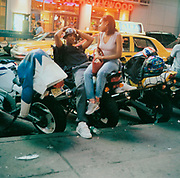 A couple sitting on a motorbike New York USA