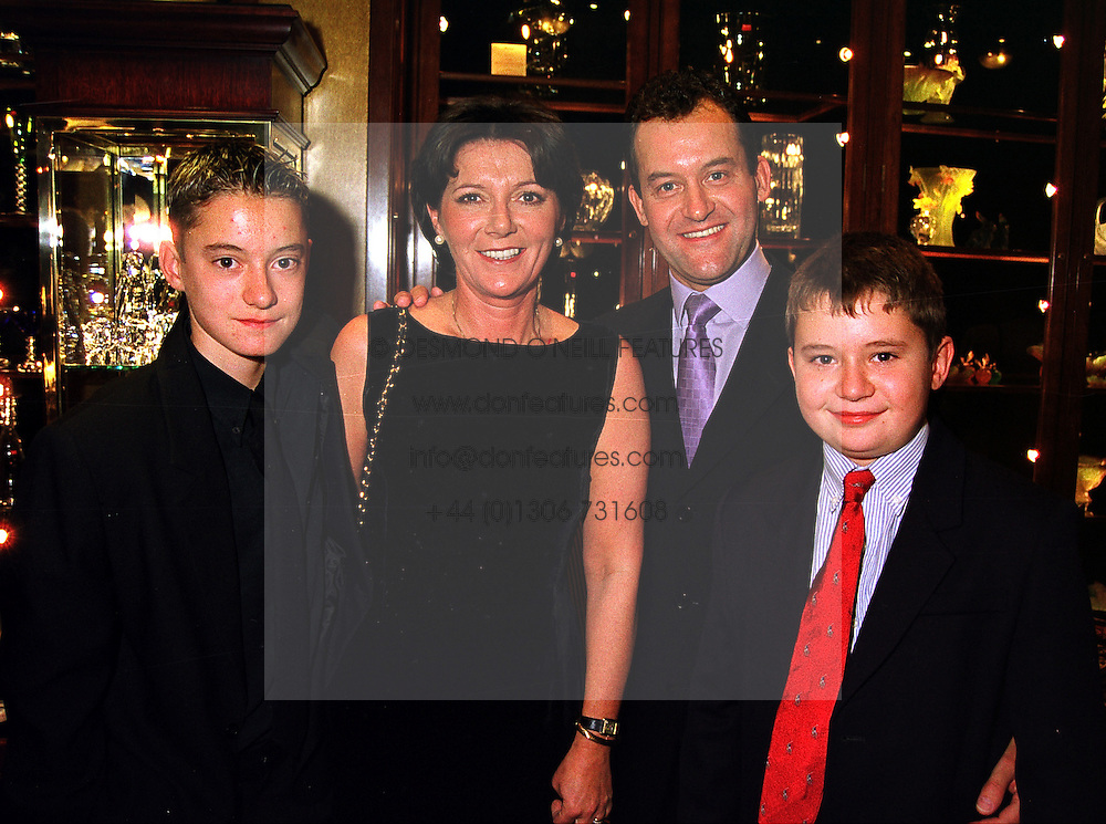 MR & MRS PAUL BURRELL, he is the former butler of the late Diana, Princess of Wales and their children, left ALEX BURRELL and NICHOLAS BURRELL at a reception in London on 5th October 1999.MXD 7