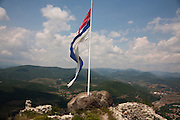 Ancient Serbian fortress on Zvecan hill. A wind-torn Serbian flag.<br /> <br /> Border crisis, July 2011