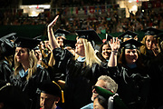Students wave to supporters at graduate commencement. Photo by Ben Siegel