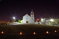 Chisrtmas Eve with luminarias at Ysleta Mission in El Paso, Texas.