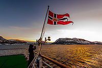 View from the stern  of the Hurtigruten ship MS Vesteralen in winter, sailing between Alesund and Molde, Norway.