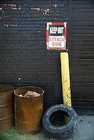 "USA, Chicago, August 25, 2009.   A forbidding sign warns casual passers-by to keep out of Meyer Steel Drum, part of LVEJO's 'toxic tour."" The Little Village Environmental Justice Organization, headquartered in a predominantly Mexican-American neighborhood of Chicago, campaigns not only against pollution but for clean power, park facilities, urban agriculture, and restoring public transit. LVEJO's staff and volunteers make significant outreach and education efforts, especially for youth. Photo for an HOY feature story by Jay Dunn."