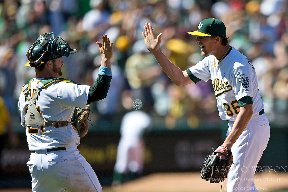 OAKLAND, CA - JUNE 21:  Tyler Clippard #36 of the Oakland Athletics celebrates with Stephen Vogt #21 after the game against the Los Angeles Angels of Anaheim at O.co Coliseum on June 21, 2015 in Oakland, California. The Oakland Athletics defeated the Los Angeles Angels of Anaheim 3-2. (Photo by Jason O. Watson/Getty Images) *** Local Caption *** Tyler Clippard; Stephen Vogt