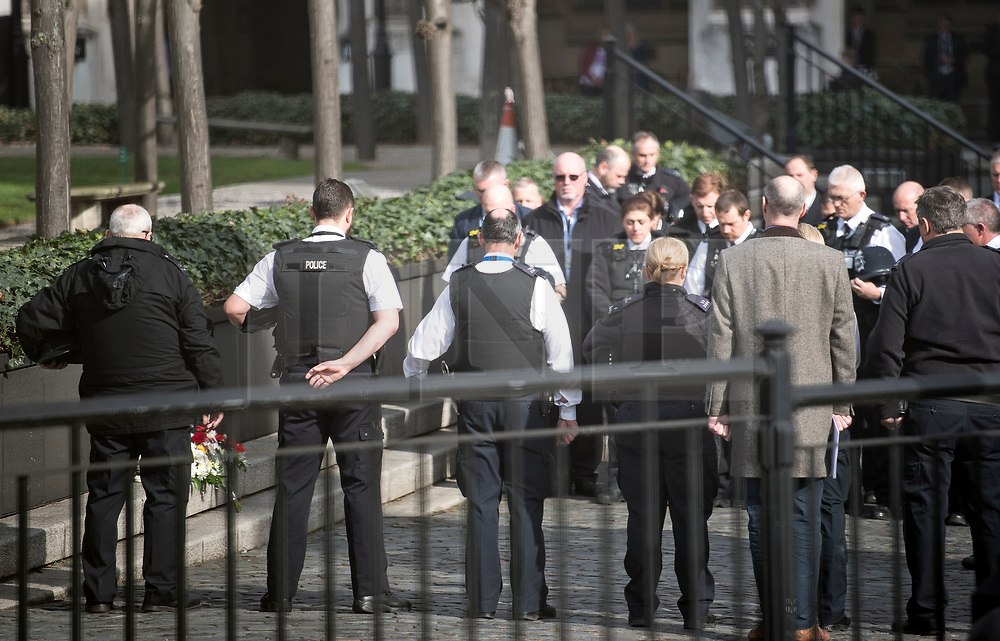 © Licensed to London News Pictures. 22/03/2018. London, UK. Members of the Police Force hold a minutes silence at New Palace Yard, inside the grounds of the Houses of Parliament in Westminster, London at the time PC Palmer died, one year ago today in the Westminster Bridge Terror attack. A lone terrorist killed 5 people and injured several more, in an attack using a car and a knife. The attacker, 52-year-old Briton Khalid Masood, managed to gain entry to the grounds of the Houses of Parliament and killed police officer Keith Palmer. Photo credit: Ben Cawthra/LNP