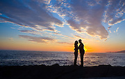 Couple Kissing At Sunset On Laguna Beach
