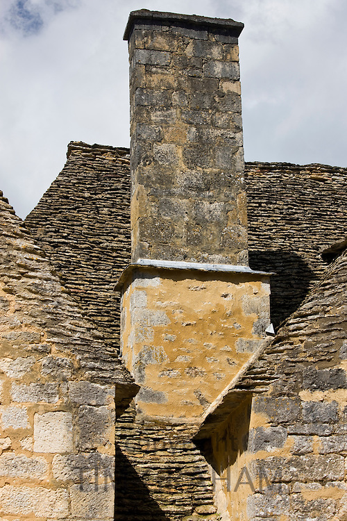 Rooves of traditional French buildings at St Amand de Coly, Dordogne, France