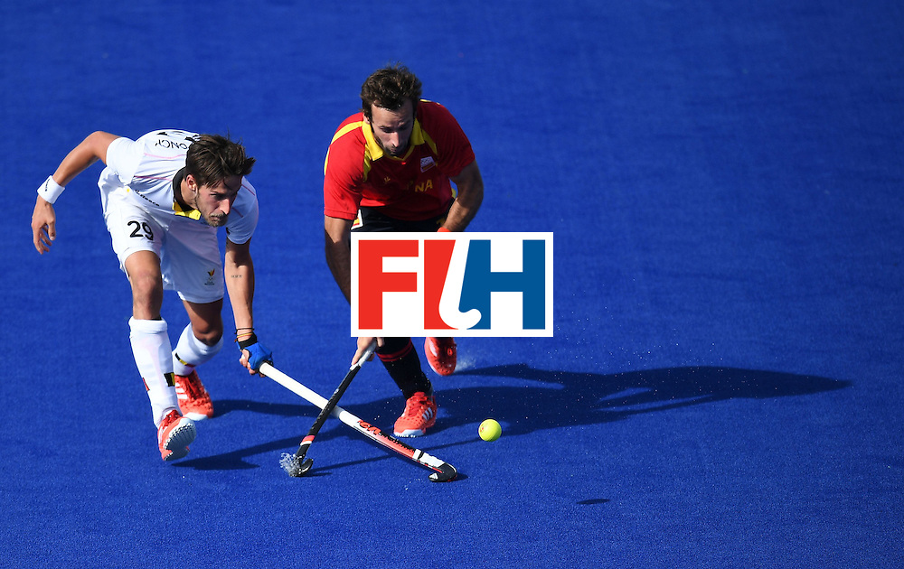 Belgium's Elliot van Strydonck vies for the ball with Spain's David Alegre during the men's field hockey Spain vs Belgium match of the Rio 2016 Olympics Games at the Olympic Hockey Centre in Rio de Janeiro on August, 11 2016. / AFP / MANAN VATSYAYANA        (Photo credit should read MANAN VATSYAYANA/AFP/Getty Images)