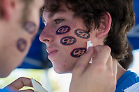Grant Gudman, a Senior at Christian Brothers, as stickers applied to his face before the game as the Jesuit Marauders play the Christian Brothers Falcons in the Holy Bowl at Hughes Stadium at Sacramento City College,  Saturday Sep 9, 2017. photo by Brian Baer