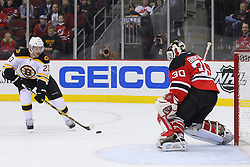 Jan 4, 2012; Newark, NJ, USA; Boston Bruins left wing Daniel Paille (20) skates in on New Jersey Devils goalie Martin Brodeur (30) during the first period at the Prudential Center.