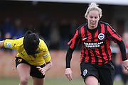 Jay Blackie and Leigh Anne Robe chase the lose ball during the Women's FA Cup match between Watford Ladies FC and Brighton Ladies at the Broadwater Stadium, Berkhampstead, United Kingdom on 1 February 2015. Photo by Stuart Butcher.