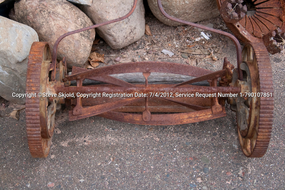Rusted antique reel style lawn mower. Business and Industrial Park. Shell Lake Wisconsin WI USA