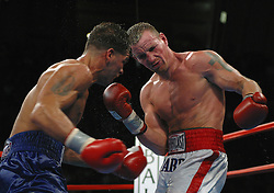 November 23, 2002; Atlantic City, NJ;  Arturo Gatti (blue trunks) and Mickey Ward (white trunks) trade punches during their second fight at Boardwalk Hall in Atlantic City, NJ.