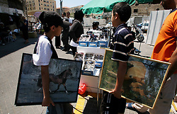 Jaffa  - May  2nd,  2008 -   Two teenage boys with horse pictures under their ams look around the local market in Jaffa, Israel,  May 2nd, 2008. Picture by Andrew Parsons / i-Images
