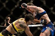 "GLASGOW, UNITED KINGDOM, JULY 16, 2017: Leslie Smith (blue shorts) versus Amanda Lemos (yellow shorts) during ""UFC Fight Night Glasgow: Nelson vs. Ponzinibbio"" inside the SSE Hydro Arena in Glasgow, Scotland on Sunday, July 16, 2017."