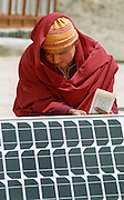 Ladakh Himalayas - Buddhist Monk sets up a solar panel - 2006