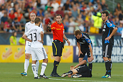 July 20, 2011; Santa Clara, CA, USA;   Vancouver Whitecaps midfielder Peter Vagenas (33) is warned by referee Paul Ward after a foul against the San Jose Earthquakes during the first half at Buck Shaw Stadium.