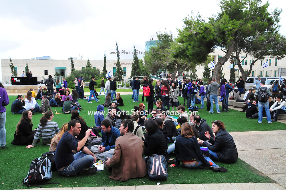 Israel, Haifa University, Students sit on the lawn during a break in studies