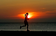A woman jogs along N. Lincoln Memorial Drive last week as the sun rises. The weather in the next few days will bring relief from the heat and lack of rain according to the forecast. Jeffrey Phelps/jphelps@journalsentinel.com