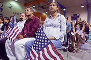 """04 JULY 2009 -- PHOENIX, AZ:  A woman from Cambodia is sworn in as a new US citizen at a naturalization ceremony in Phoenix, AZ, July 4. U.S. Citizenship and Immigration Services and South Mountain Community College in Phoenix, AZ, hosted the 21st annual """"Fiesta of Independence"""" Saturday, July 4. More than 180 people from 58 countries took the US Oath of Citizenship and became naturalized US citizens. The ceremony was one of dozens of similar ceremonies held across the US this week. USCIS said more than 6,000 people were naturalized US citizens during the week.  Photo by Jack Kurtz / ZUMA Press"""