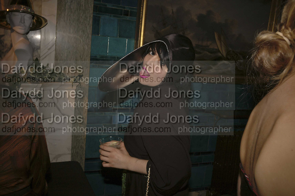 Hannah Hanra Stephen Jones Summer Hat party to celebrate 25 years of Milllinery. Debenham House, 8 Addison Rd. Holland Park, London. 13 July 2006.  ONE TIME USE ONLY - DO NOT ARCHIVE  © Copyright Photograph by Dafydd Jones 66 Stockwell Park Rd. London SW9 0DA Tel 020 7733 0108 www.dafjones.com