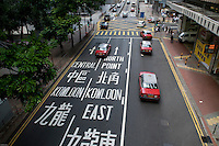 Chinese and latin characters give directions, Hong Kong.