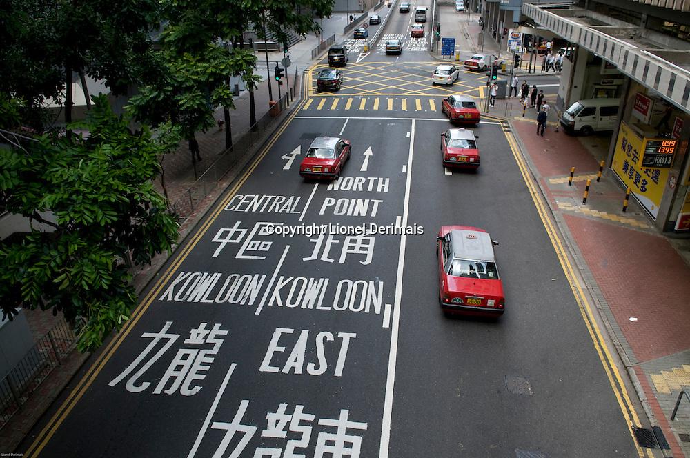 Chinese and latin characters give directions, Hong Kong.